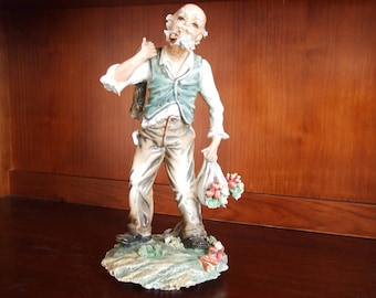 Capodimonte signed figurine of an old man/gardener