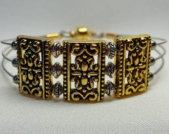 Guitar String Bracelet Triple Strand Gold Sliders Silver Bali Beads