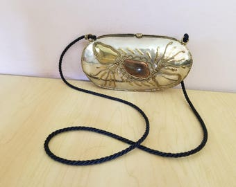 Women vintage handmade metal purse on string