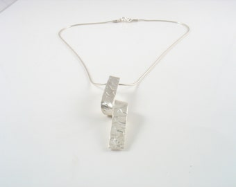 vertically or horizontally sterling silver textured  pendant, elegant both way, look different either-way,casual yet elegant and delicate
