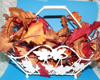 White metal Basket with Handle and Leaf shaped Design full of  Artificial Fall Leaves