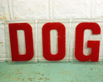 Three Vintage Clear and Red Plastic Marquee Sign Letters Spelling DOG