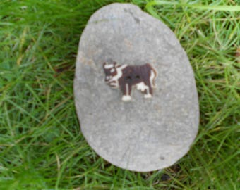 Brown cow button