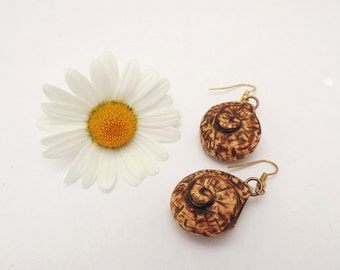 Wooden miniature snail shell earrings - handcarved and wood-burning decorated