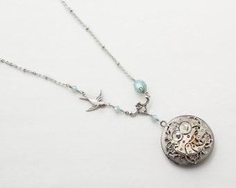 Steampunk Locket Necklace Vintage watch movement on filigree flower with blue opal Swarovski crystal & silver bird pendant jewelry gift