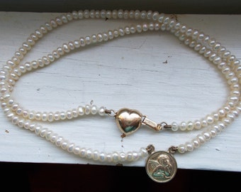 Solid 14k yellow gold and pearl Cupid and heart necklace