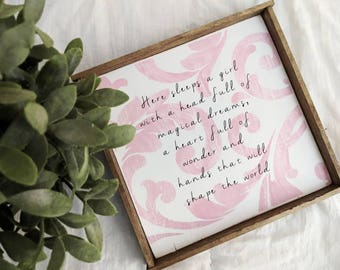 Farmhouse inspired 'Here sleeps a girl' framed wooden sign with damask background