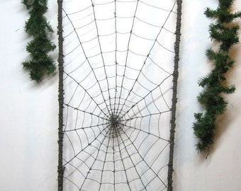 Amazing 66 Inch  Barbed Wire Trellis With Spider Spinning Her Web