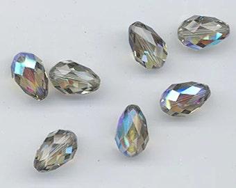 Twelve vintage Swarovski crystal beads - Art. 5500 - 12 x 8 mm - black diamond AB