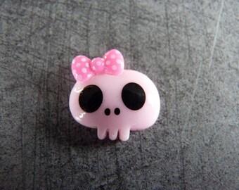 Pretty little pink child skull head