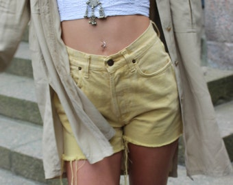 VINTAGE Yellow high-waisted ripped cut-offs / jeans shorts