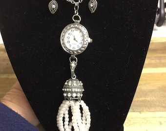 Pendant with watch accent.