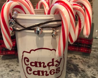 Christmas insired hand painted and distressed wide mouth pint size mason jar in an off white color (candy not included)