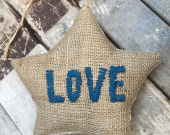 Burlap and linen and embroidered star cushion