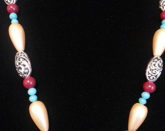 Lovely cream and cranberry beaded necklace and earrings. Perfect gift for the women in your life.