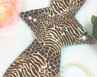 """14"""" Heavy Asymmetrical Cotton Top Cloth Pad/Mama Cloth/Rumps/Incontinence Care Pads in Animal Print With Blue Fleece Backing"""