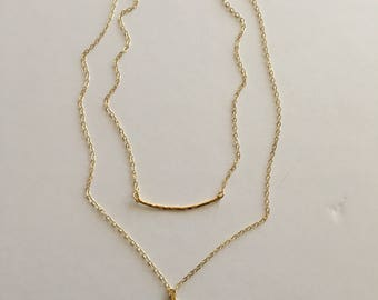 "Delicate gold filled chains add a pretty, layered look, with a lightly hammered gently arched pendant bar and 1 1/2"" long  pendant"