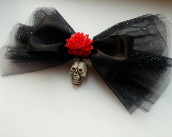 Big hairbow, made with black netting, a skull, a black ribbon bow, and a red rose!