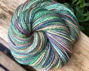 Handspun yarn, pale pinks and greens, lavender, baby blue, rust and gold tones, 100% merino wool, DK worsted weight, three ply