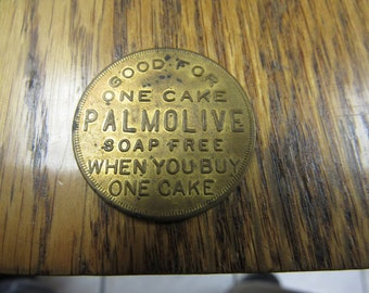 Token Good for one cake Palmolive Soap Free When You Buy One Cake.