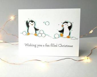 Penguin Christmas card, penguin snowball fight Christmas greeting card.