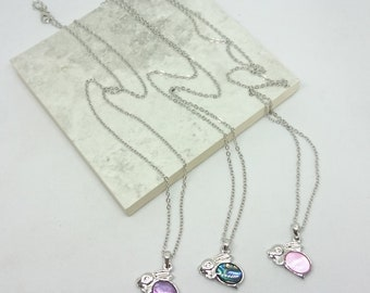 """Bunny Rabbit necklace - Easter bunny style pendant with an option of purple, green (natural) or Pink paua shell insert on a 18"""" trace chain."""
