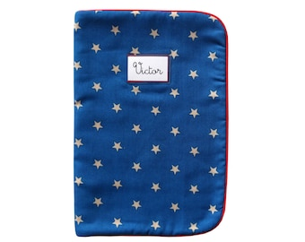 Health Book fleece printed fabric beige stars on Royal blue red piping