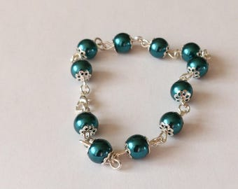 Dark Green Pearl glass bead bracelet and silver colored Corolla