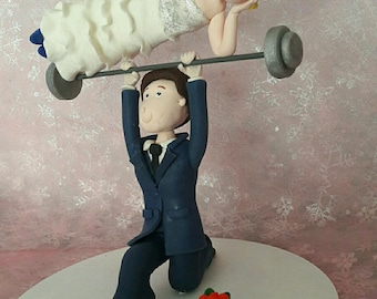 Groom couple to put on the cake that looks like you
