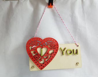 Handmade beautiful unquie painted wall hanging l Love you. For that special person a large heart surrounds little heart flowers and swirls.