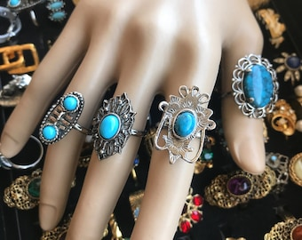 lot of 4 rings with faux turquoise