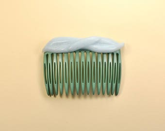 Green comb with soft blue silicone decoration