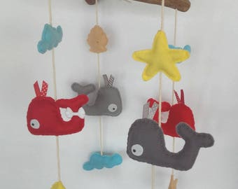 Felt mobile and drift wood, red and gray whale and its elements