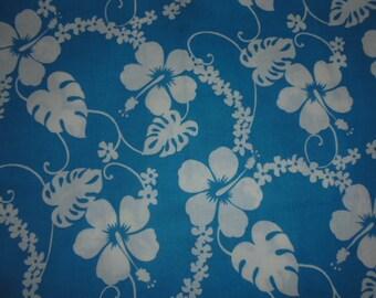 Hibiscus on turquoise fabric