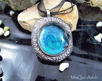 Pendant in antiqued silver with large blue stone
