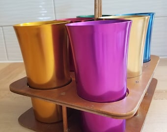 Anodized Aluminum Drinking Glasses made in the USA by Bascal in wood carrier / holder.