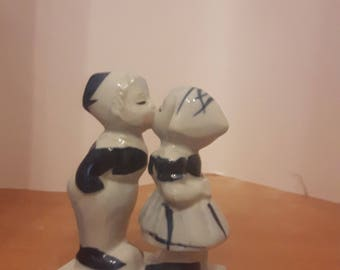 Holland delft figurines of a boy and a girl