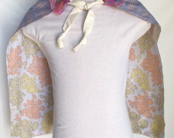 Reversible childrens cape with lace detail