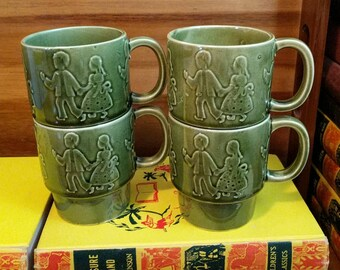 Vintage Japan Avocado Green Glazed Pottery Boy and Girl Kids Stacking Mugs Set of 4