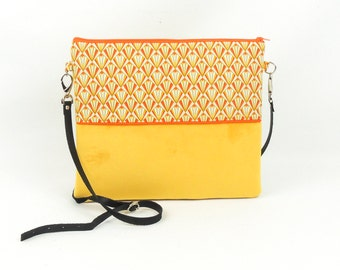 Yellow velvet clutch bag
