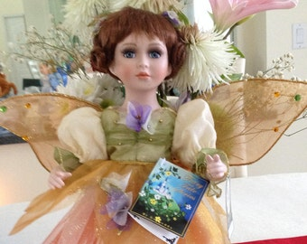 Beautiful Auburn Haired Fairy Doll in beautifully detailed clothing.