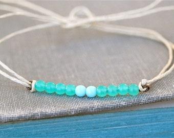 Sea meets sky.glass beaded string bracelet.Tiedupmemories