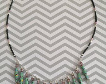 Green necklace and silver sequins