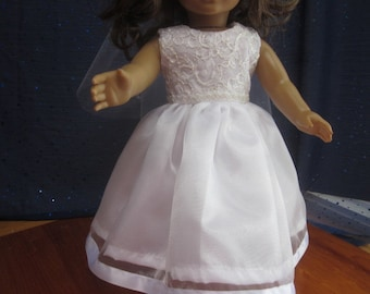 communion dress and veil will fit your 18 inch doll such as American Girl