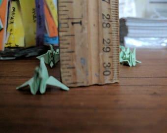 10 tiny green cranes!