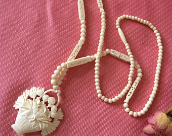 Vintage Carved Plastic Necklace. Beautiful, Feminine Flower Basket Pendent on Bead Chain With Decorative Bead Accents.