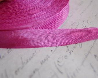 1/2 inch wide Magenta Vintage Seam Binding Ribbon