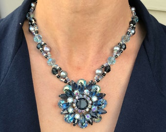 Waltz - Vintage Blue Rhinestone Brooch on an interweaving helix of Swarovski Crystals, freshwater pearls, rhinestone rondells and spacers