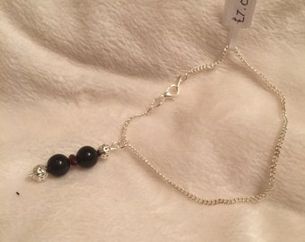 Silver bracelet with obsidian and red garnet