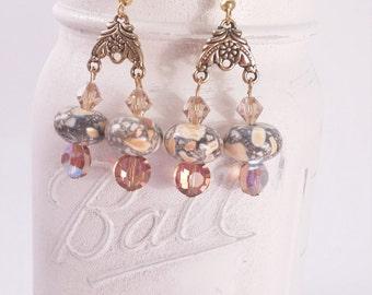 Gold tone and orange marble dangle earring